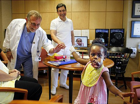 smiling doctors and a child patient