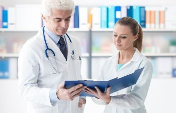 Doctors Reviewing Medical Files